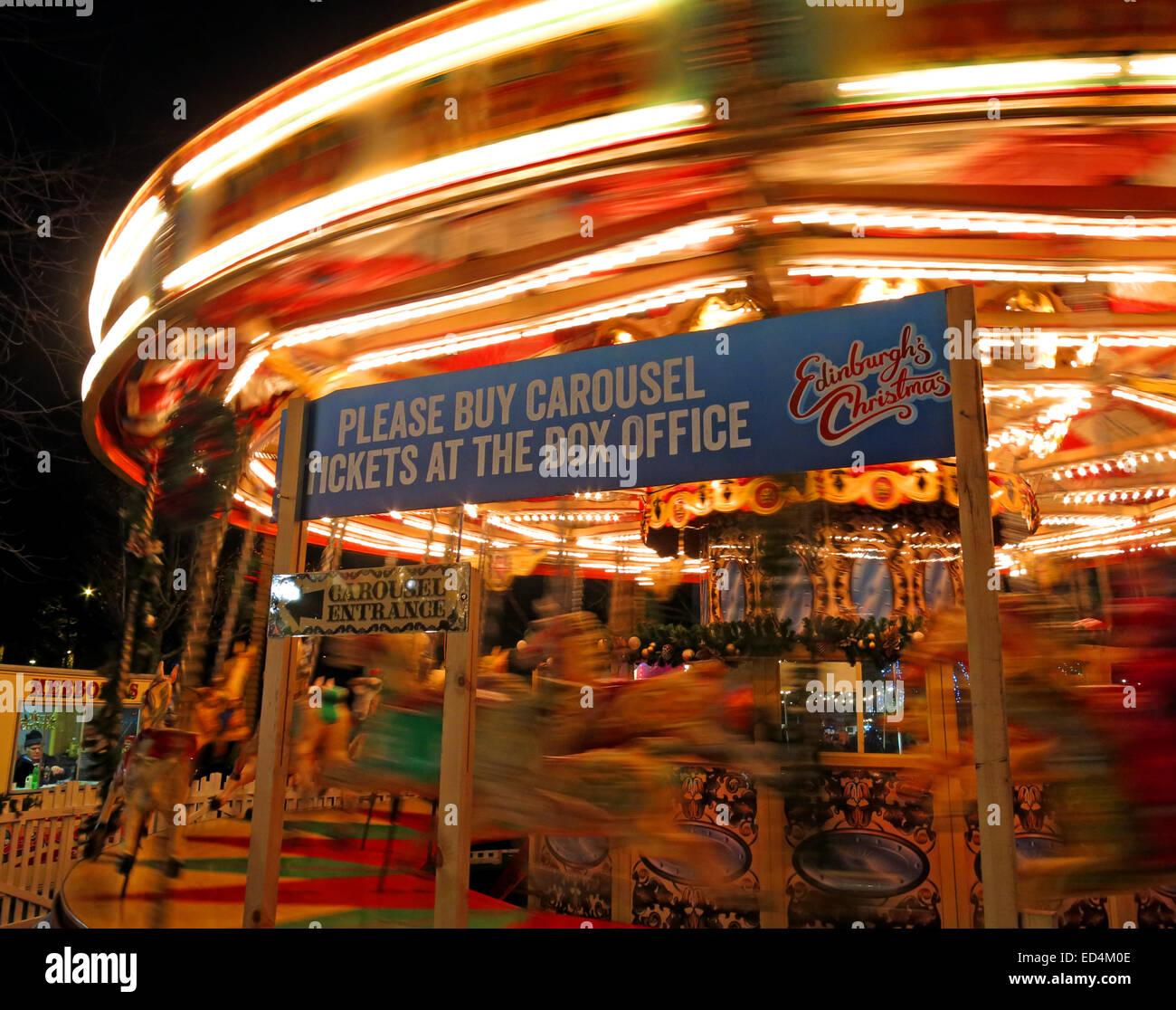 attraction,slide,slides,Edinburgh,dusk,at,St,Andrew,Square,Christmas,Xmas,festival,moving,merry,go,around,Edinburghs,Hogmanay,sign,saying,please,buy,carousel,tickets,at,the,box,office,moving,movement,Tourist,tourism,fun,track,things,to,see,do,GotonySmith,Go Tony Smith,GoTonySmith