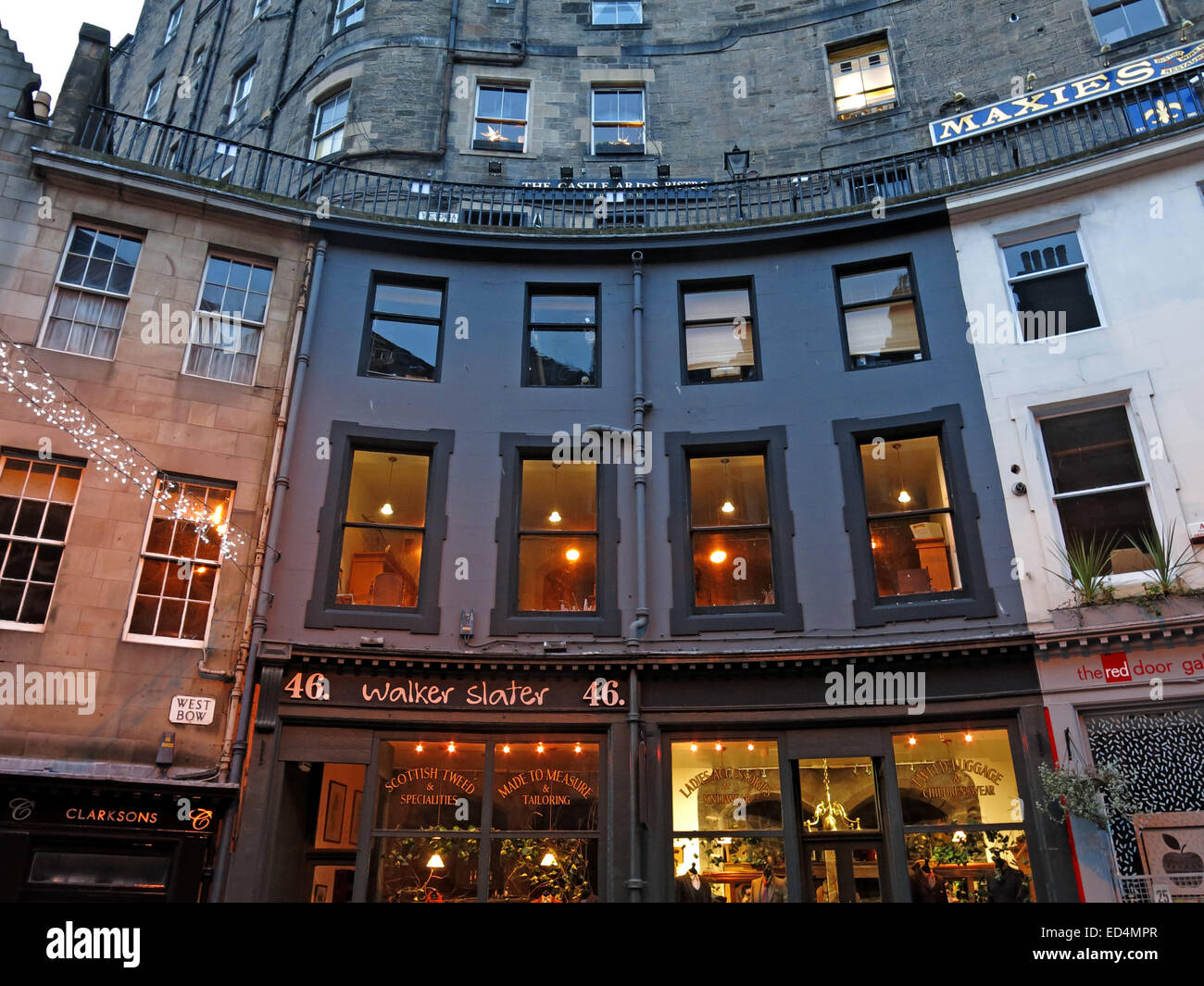 Street,Scottish,building,Street,with,historic,architecture,elegant,curve,colourful,shop,fronts,is,one,of,the,city's,most,picturesque,location,old,West,Bow,Grassmarket,to,Castlehill,Lothian,Scotland,UK,Edinburgh,tourist,trail,track,tourism,night,dusk,xmas,christmas,gotonysmith buildings tourists history,Buy Pictures of,Buy Images Of
