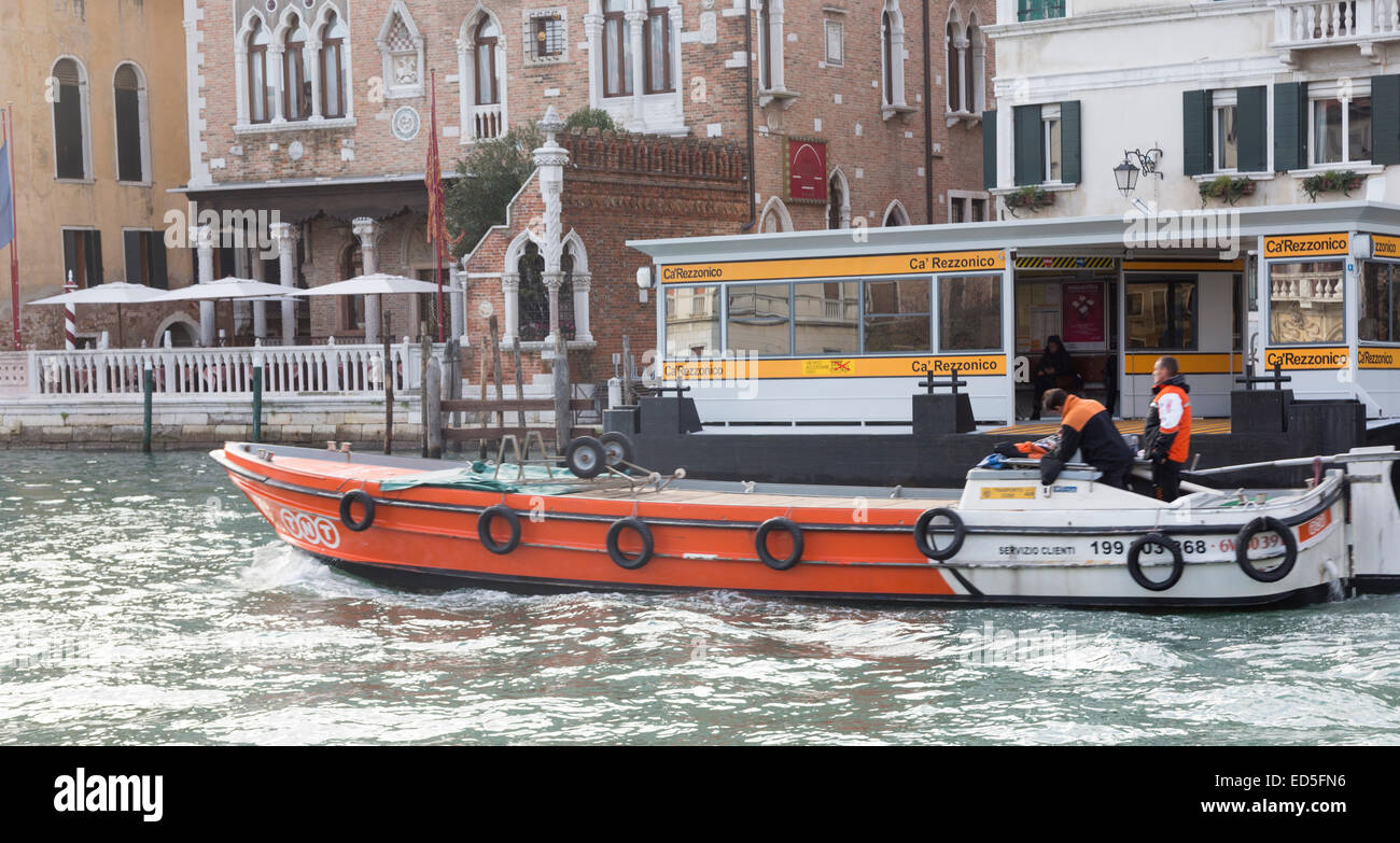 TNT Express courier boat delivering packages, Grand Canal, Venice, Italy - Stock Image
