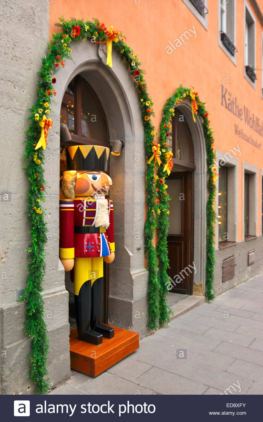 A Life Size Toy Soldier Watches Passersby From Doorway In Kathe