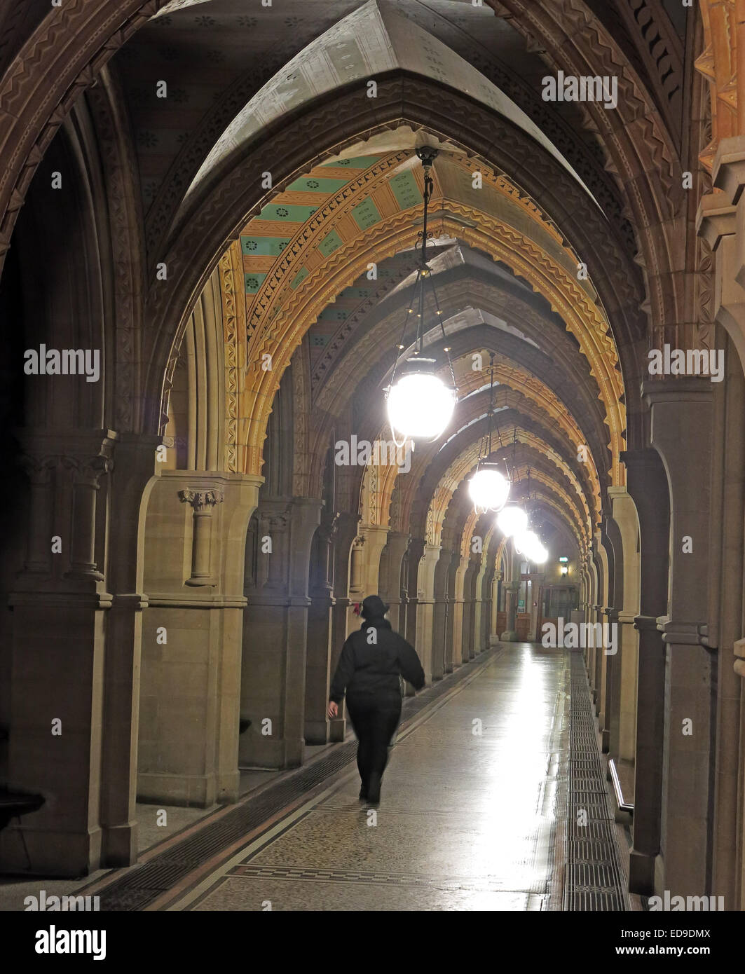 Corridor person walking down a silhouette shadow Victorian,Neo-gothic,municipal,building,neogothic,stone,marble,ceremonial,headquarters,city,council,architect,Alfred,Waterhouse,grand,ceremonial,rooms,Great,Abel,the,clock,bell,Grade,I,listed,one,Corporation,walk,walks,lighted,lit,inside,interior,GoTonySmith Manchester Town Hall is a Victorian,Neo-gothic municipal building in Manchester,England.,It,is,the,ceremonial,headquarters,of,Manchester,City,Council,and,houses,a,number,of,local,government,departments.,The,building,faces,Albert,Square,to,the,north,featuring,the,Albert,Memorial,and,St,Peters,Square,to,the,south,home to The Cenotaph. Designed by architect Alfred Waterhouse,the,town,hall,was,completed,in,1877.,The,building,contains,offices,and,grand,ceremonial,rooms,such,as,the,Great,Hall,which,is,decorated,with,Ford,Madox,Browns,imposing,Manchester,Murals,illustrating,the,history,of,the,city.,The,entrance,and,Sculpture,Hall,contain,busts,and,statues,of,influential,figures,including,Dalton,Joule,and,Barbirolli.,The,exterior,is,dominated,by,the,clock,tower,which,rises,to,280,feet,(85,m),and,houses,Great,Abel,the clock bell