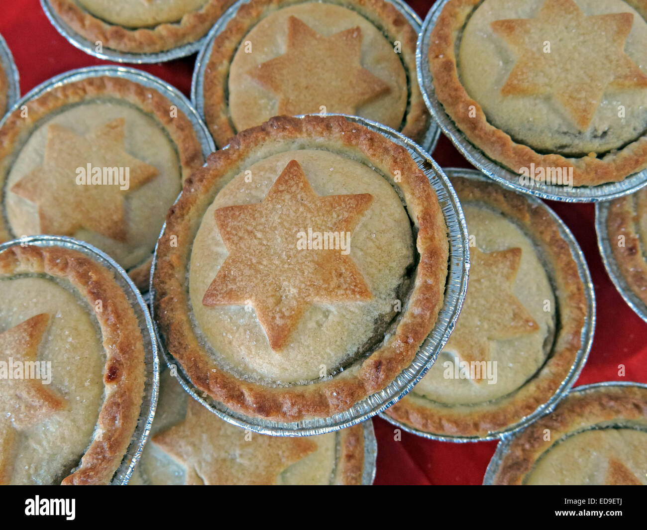 Jewish,symbol,Jew,Judaism,in,tin,aluminum,cup,MrKipling,Mr,Kipling,Christmas,tasty,treat,sugar,desert,festive,food,confectionery,at,Xmas,on,a,red,table,fat,fatty,British,fruit-based,mincemeat,season,European,crusaders,mutton,shrid,pie,English,cinnamon,cloves and nutmeg catholic,GoTonySmith,Buy Pictures of,Buy Images Of