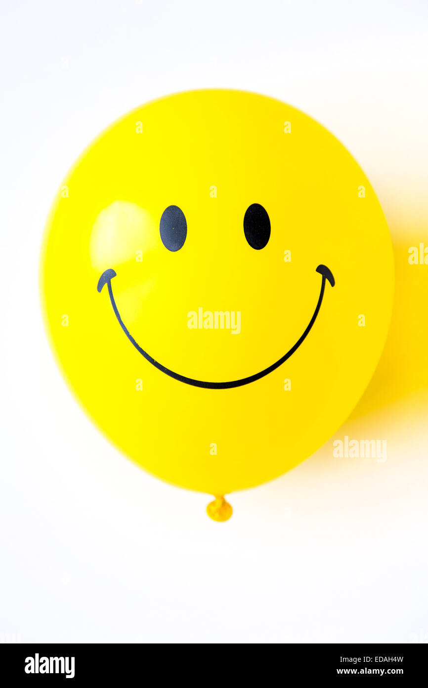 Balloon, yellow, with friendly smiley face Stock Photo