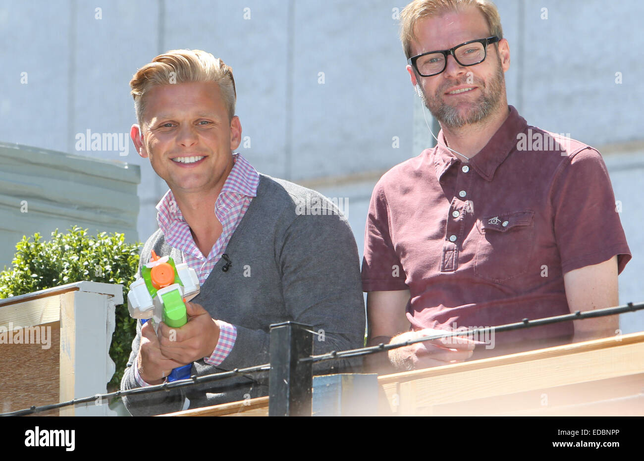 jeff brazier squirting water at the loose women during filming stock