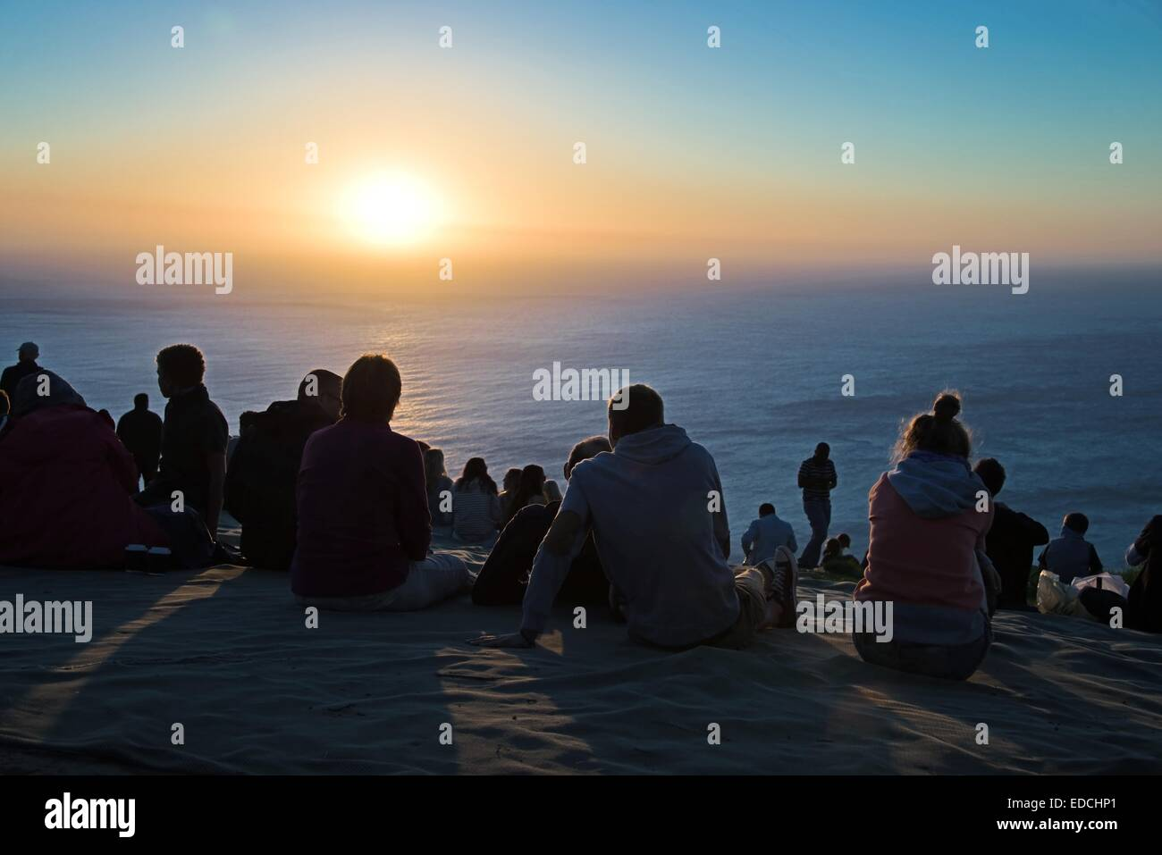 People enjoying the sunset at Signal Hill, a hill famous for its view on Cape Town city. - Stock Image