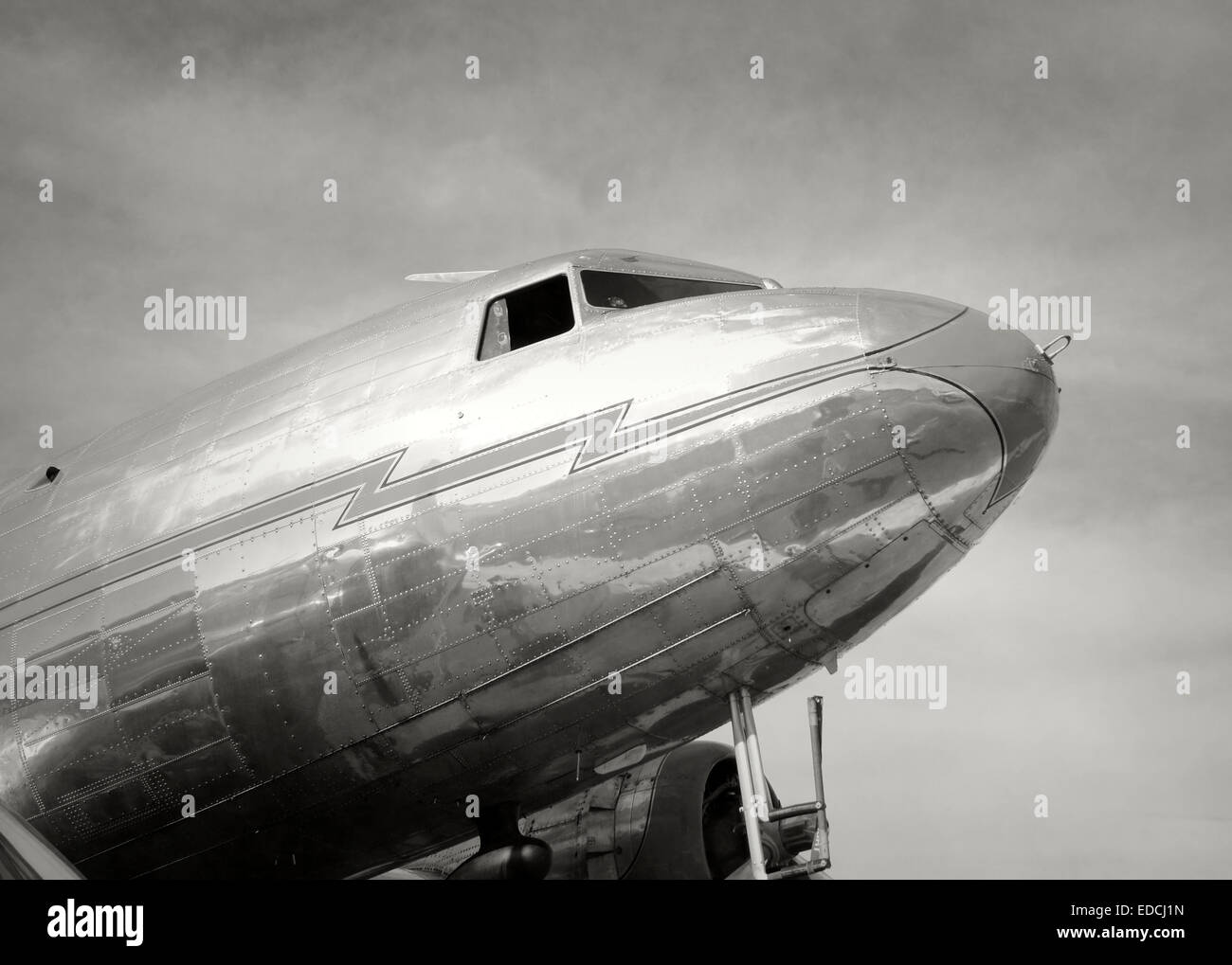 Old DC-3 propeller airplane in black and white - Stock Image