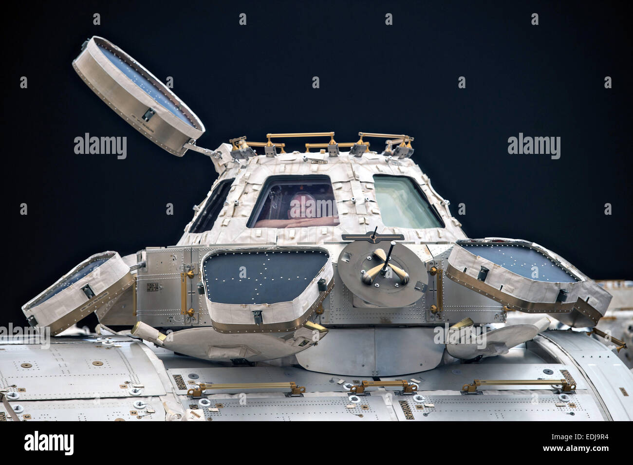US Astronaut Barry Wilmore, Commander of Expedition 42 aboard the International Space Station looks out of the Cupola - Stock Image