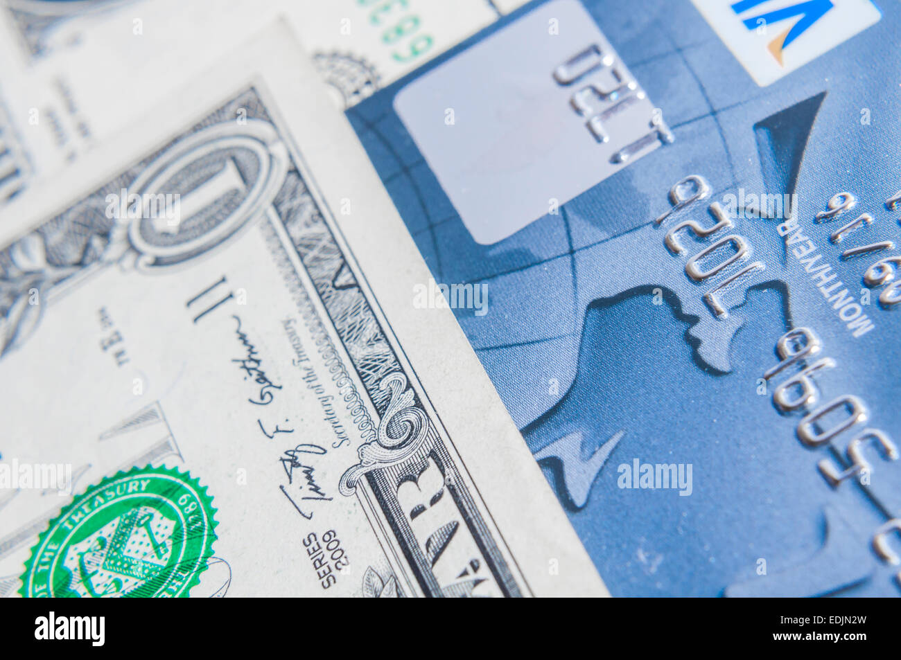 Credit Card on dollar bills as wealthy concept - Stock Image