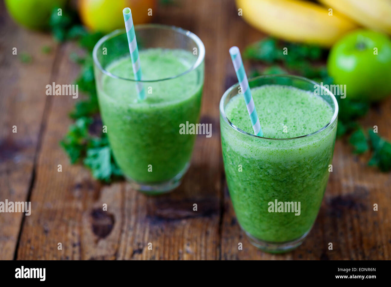 Green smoothies with kale and apples - Stock Image