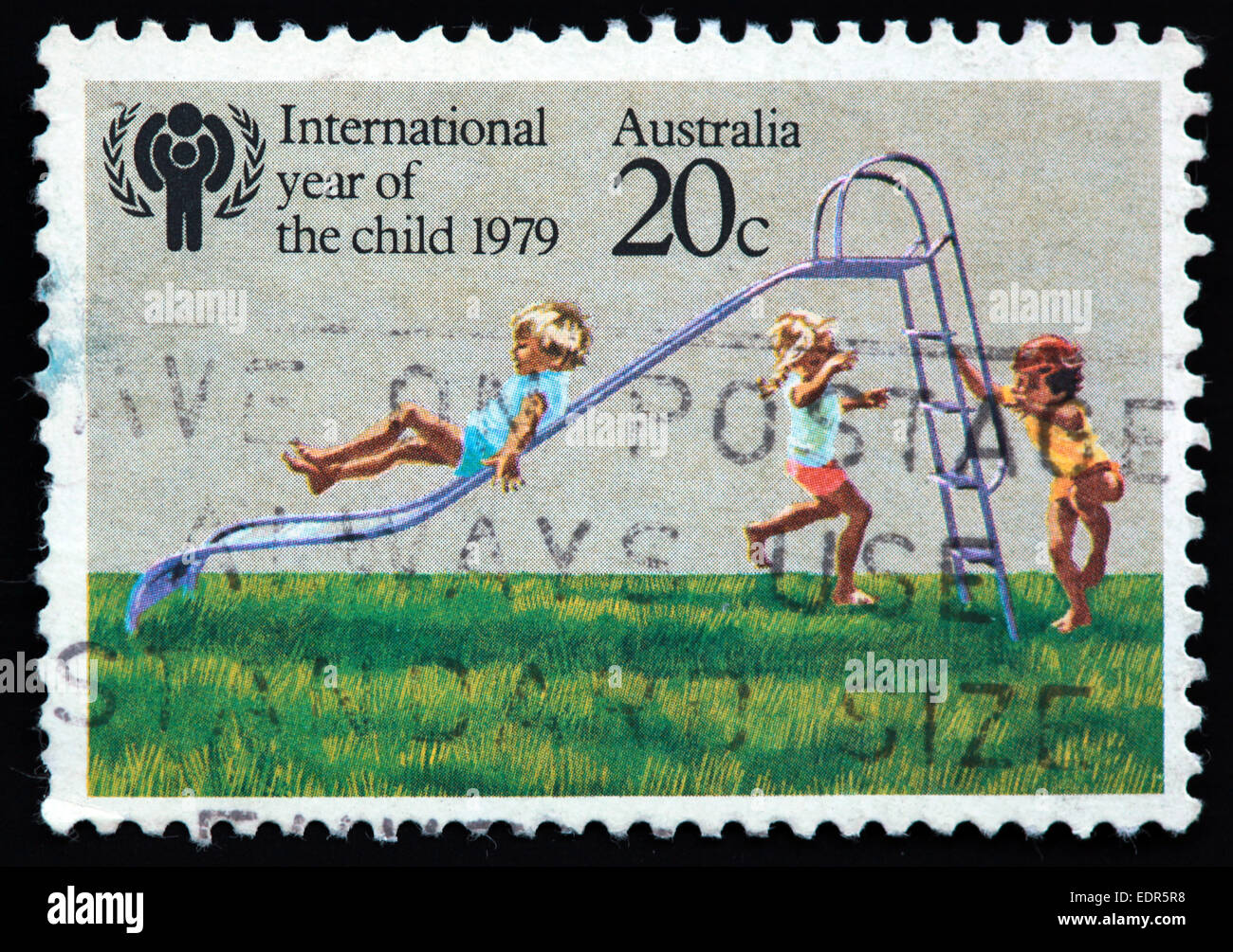 International Year of the child,international,year,of,the,child,children,play,playing,on,a,slide,unicef,grass,recreation,stamp,Used,and,postmarked,Australia,Austrailian,Stamp,post,posting,mail,hobby,perforation,mark,postage,stamp,print,stamp,cancelled,stamp,payment,correspondence,po,Gotonysmith,todler,todlers,babies,juveniles,kid,kids,philatelist,letter,price,history,retro,Australian,Vintage,delivery,date,relationship,communication,Oz,Australia,DownUnder,classic rare unique Austrailian financial,investment,invest,value,British,empire,nation,canceled,printed on black background,close-up,closeup,close,up,sent,send,philately,mailing,shipping,postoffice,office,isolated,circa,special,colour,color,postmarked,marked,airmail,aged,antique,retro,cutting,historic,old,stamps,collection,stamp collection,album,Timbre,Sello,Stempel,Selo,Down Under,Black background,Buy Pictures of,Buy Images Of