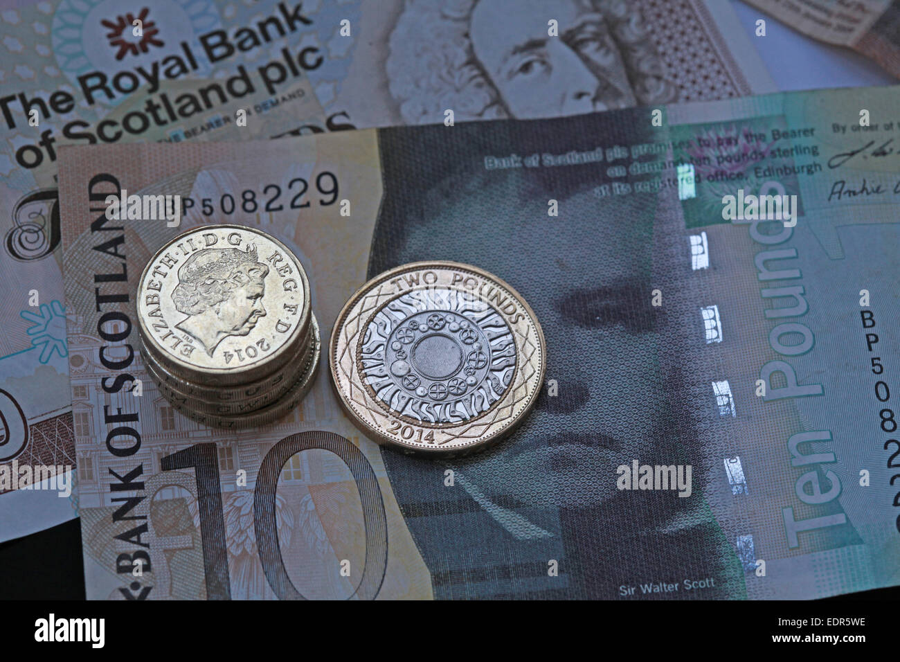 uk,Britain,British,pound,pounds,currency,Europe,banknotes,close,up,close-up,notes,still-life,stilllife,system,capital,capitalist,system,capitalism,closeup,cut-outs,cut,out,finances,financial,crisis,nobody,notes rbs bos clydesdale banks,Tartan Economy,welfare reform,Gotonysmith,retail-bank,retail,banknote,Scots,economy,economic,crisis,tax,HB,benefit,universal,welfare reform wallpaper landscape horizontal city,business,stack,pile,cash,wealth,wealthy,prosperity,mean,institutions invest,stock,speculate cash wonga prosperous,prosper,prosperity,wealth,wealthy,rich,poor,success,successful pile tartan,economy,crash,recession,British,Union,unionist,45,55,banknotes,Charter,Act,1844,coinage,Commissioners,for,Revenue,and,Customs,of,Issue,Universal benefit,Buy Pictures of,Buy Images Of