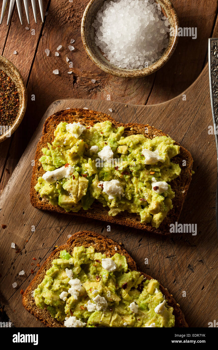 Healthy Homemade Avocado Toast with Salt and Feta - Stock Image