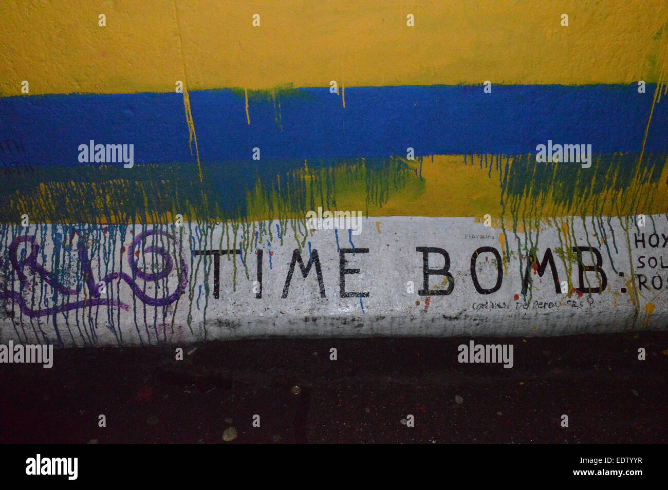 Image if street art at east side gallery in Berlin - 'Time Bomb' - Stock Image