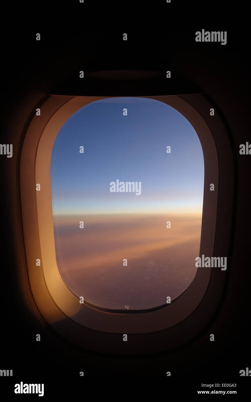 View out of an Airbus A320 window at sunset over USA America Stock Photo