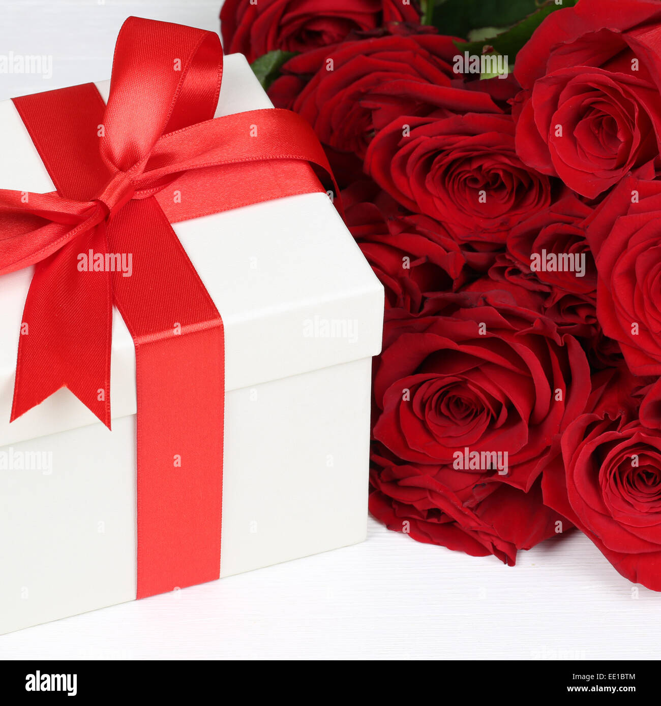 Present with roses flowers for birthday gifts valentines or stock present with roses flowers for birthday gifts valentines or mothers day izmirmasajfo
