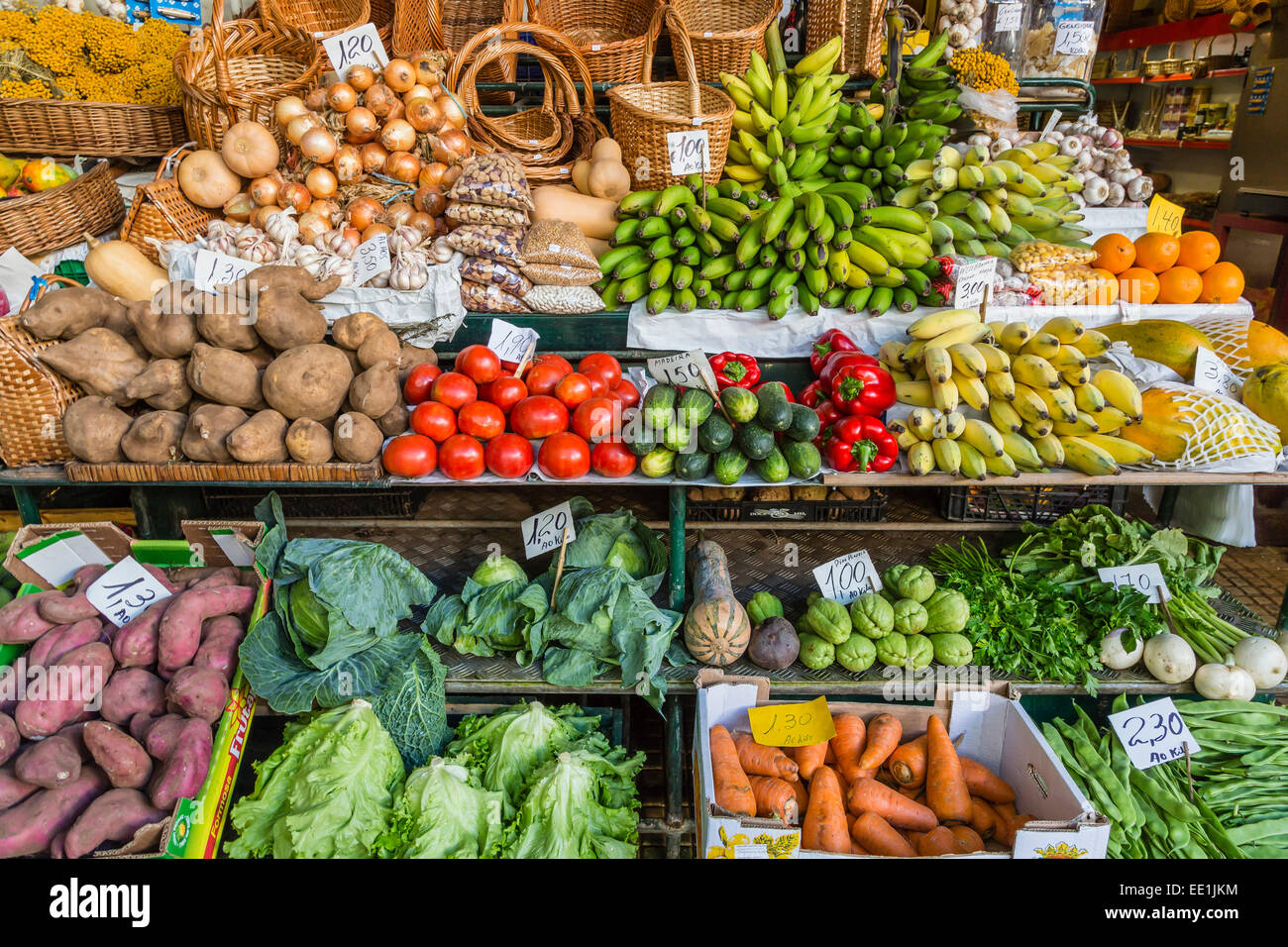 Vendors inside the Funchal Market, where fresh produce and fish are sold in the capital city of Funchal, Madeira, - Stock Image