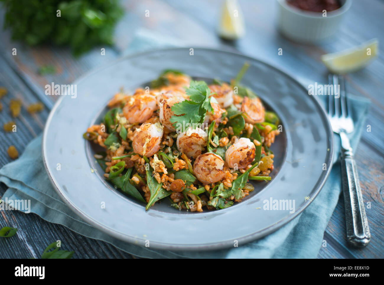 Harissa rice and greens and seared shrimp - Stock Image