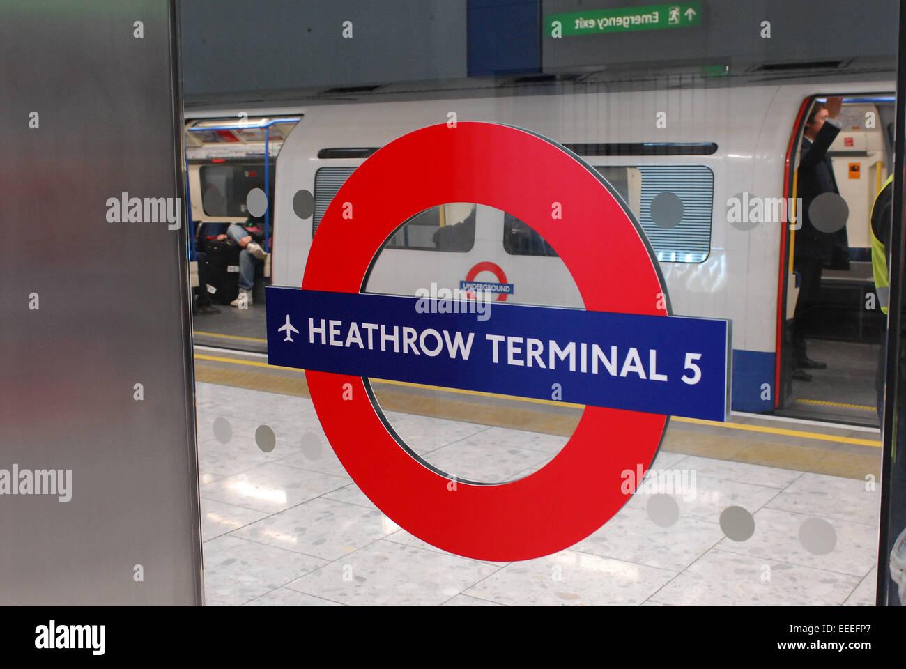 Station roundel at Heathrow Terminal 5 Underground station - Stock Image