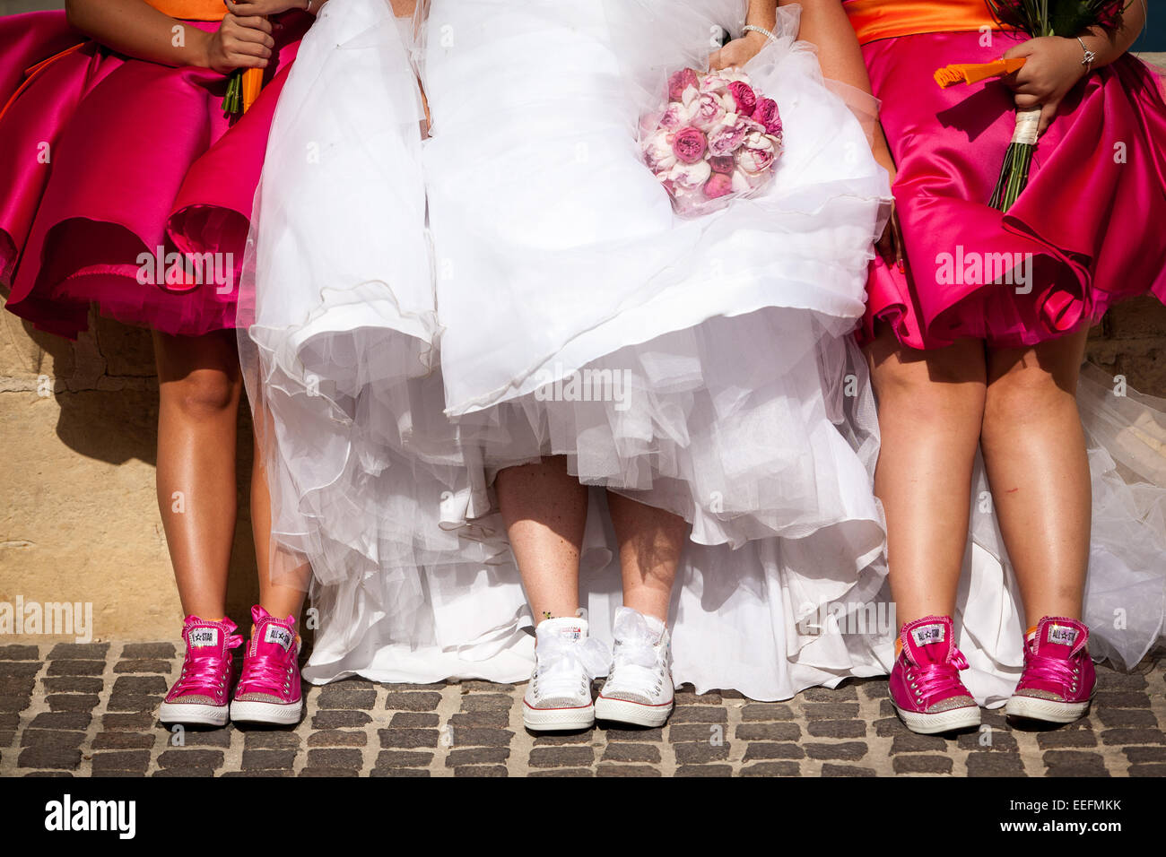 bride and her bridesmaids in their wedding trainersStock Photo