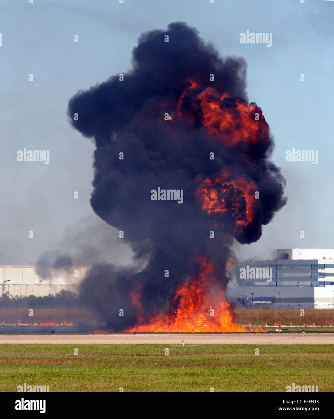 Giant outdoor explosion with flames and smoke - Stock Image