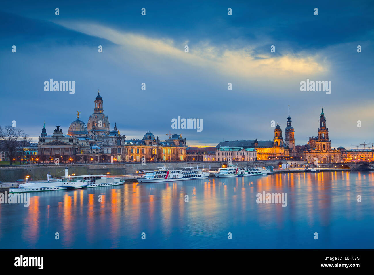 Dresden. Image of Dresden, Germany during twilight blue hour with Elbe River in the foreground. - Stock Image
