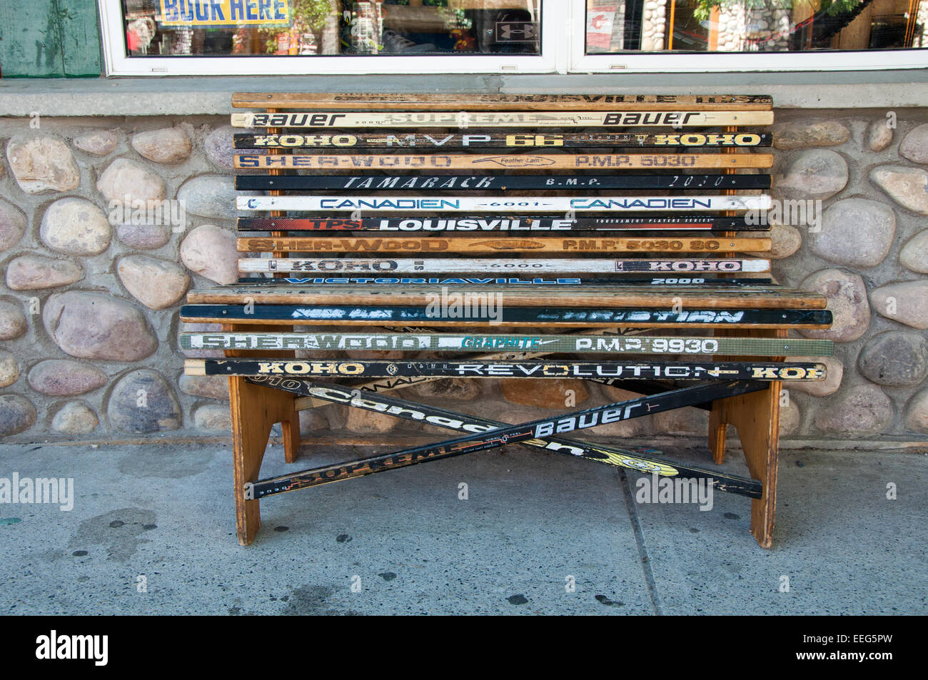 Bench made from old ice hockey sticks - Jasper, Canada - Stock Image
