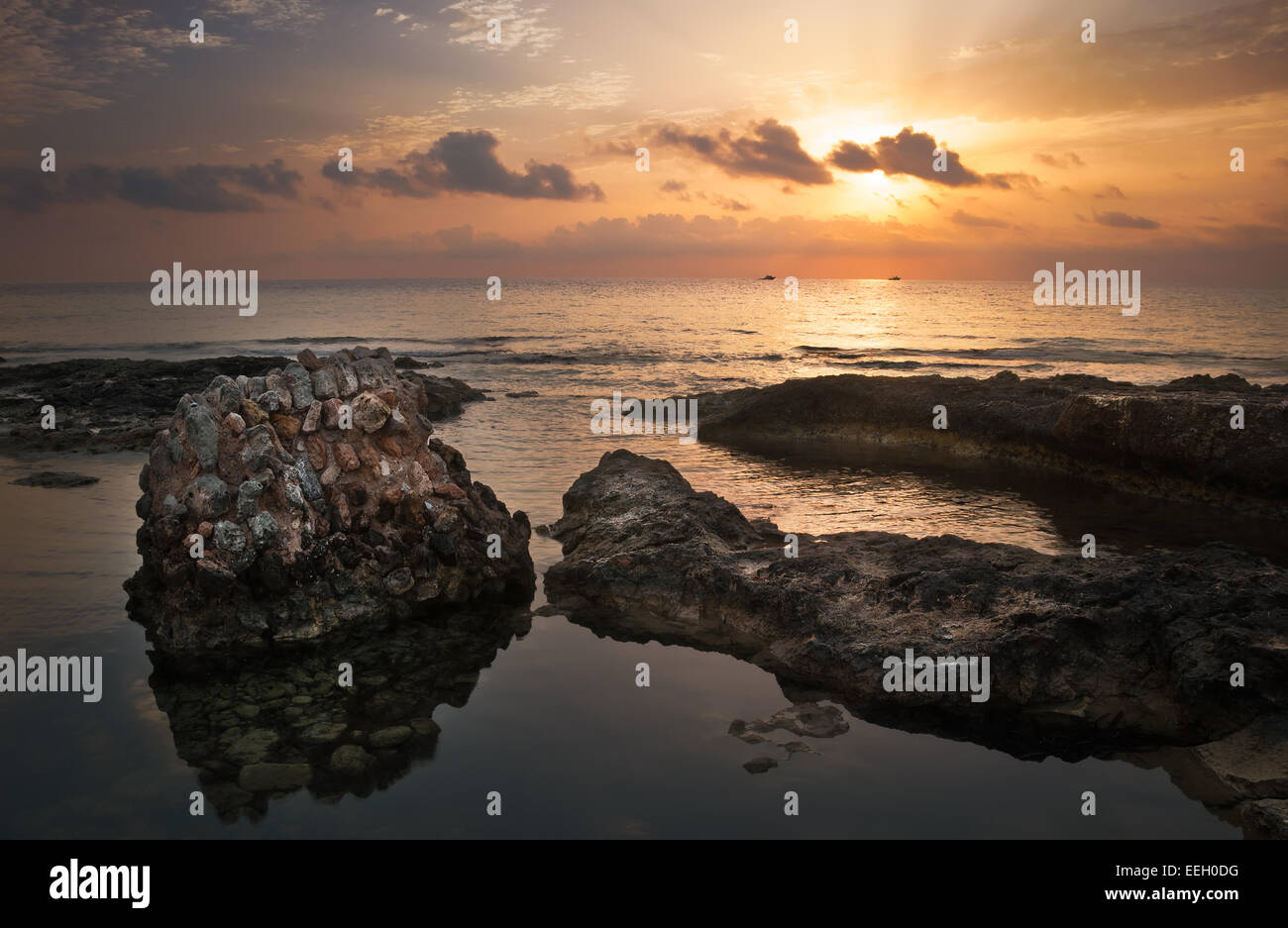 Sunset over the Sea and Rocky Coast with Ancient Ruins in Mahdia, Tunisia - Stock Image