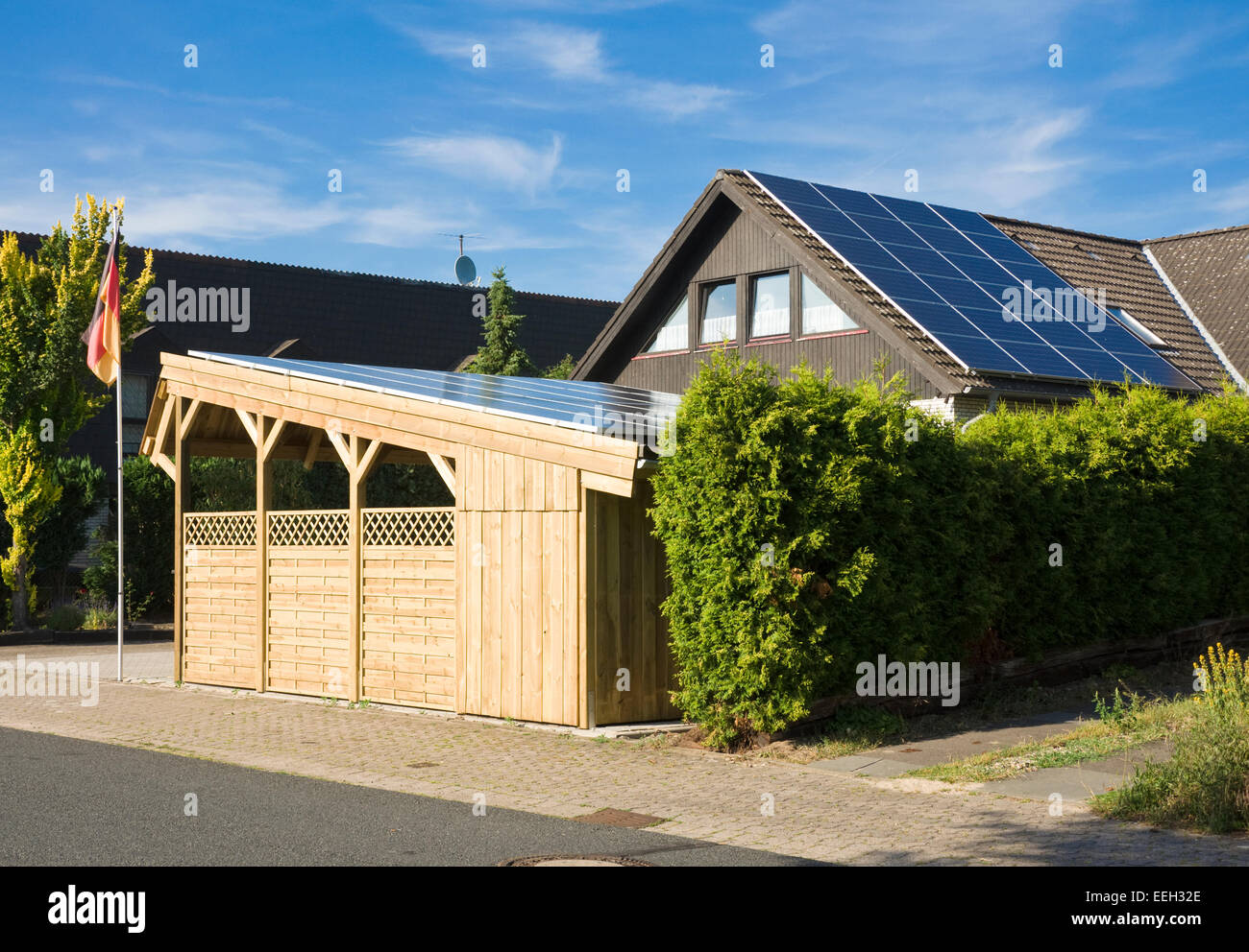Solar Carport 'Sunport' providing shelter and charging energy for two electric cars or plug-in hybrid like - Stock Image