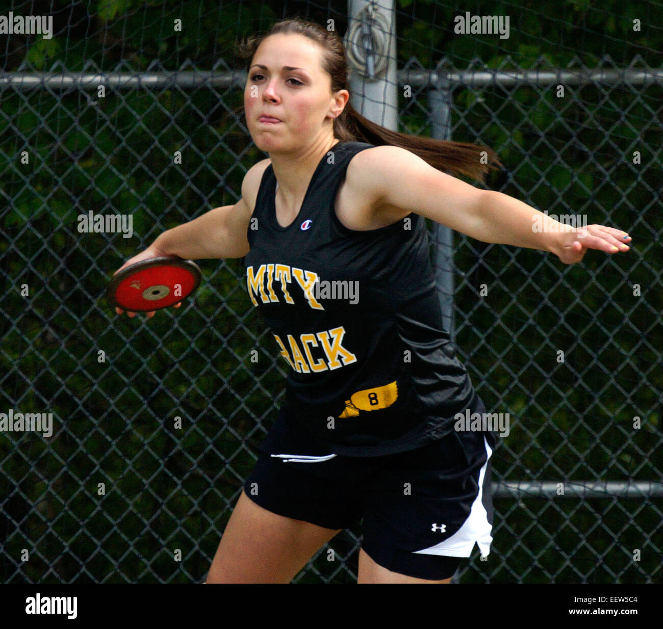 Amity, CT USA-- Amity's Katherine Simon throws 98' during the discus at SCC East Sectional Track Meet.  - Stock Image