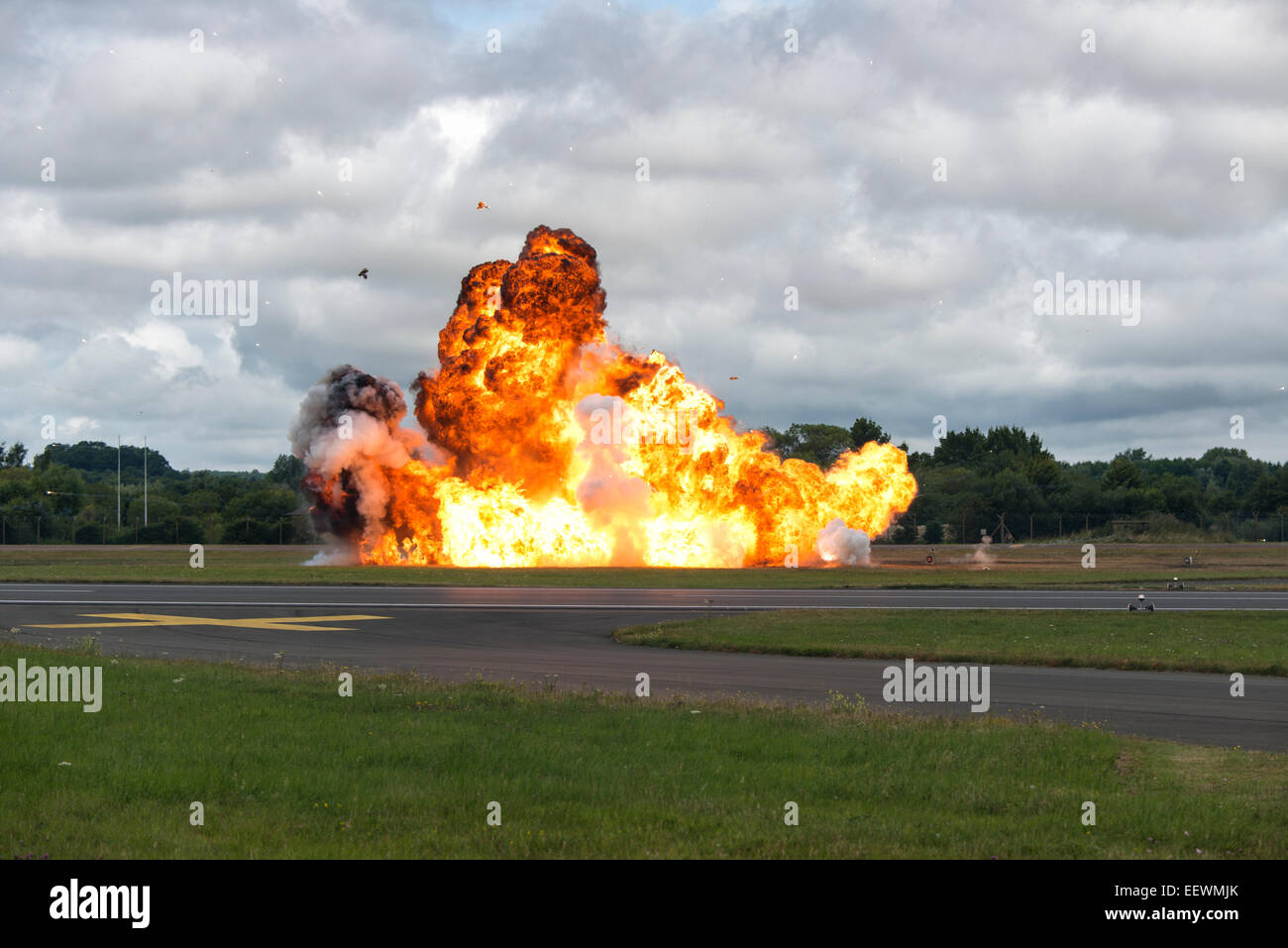 Large explosion at the Royal International Air Tattoo simulates a ground attack by British Aircraft - Stock Image