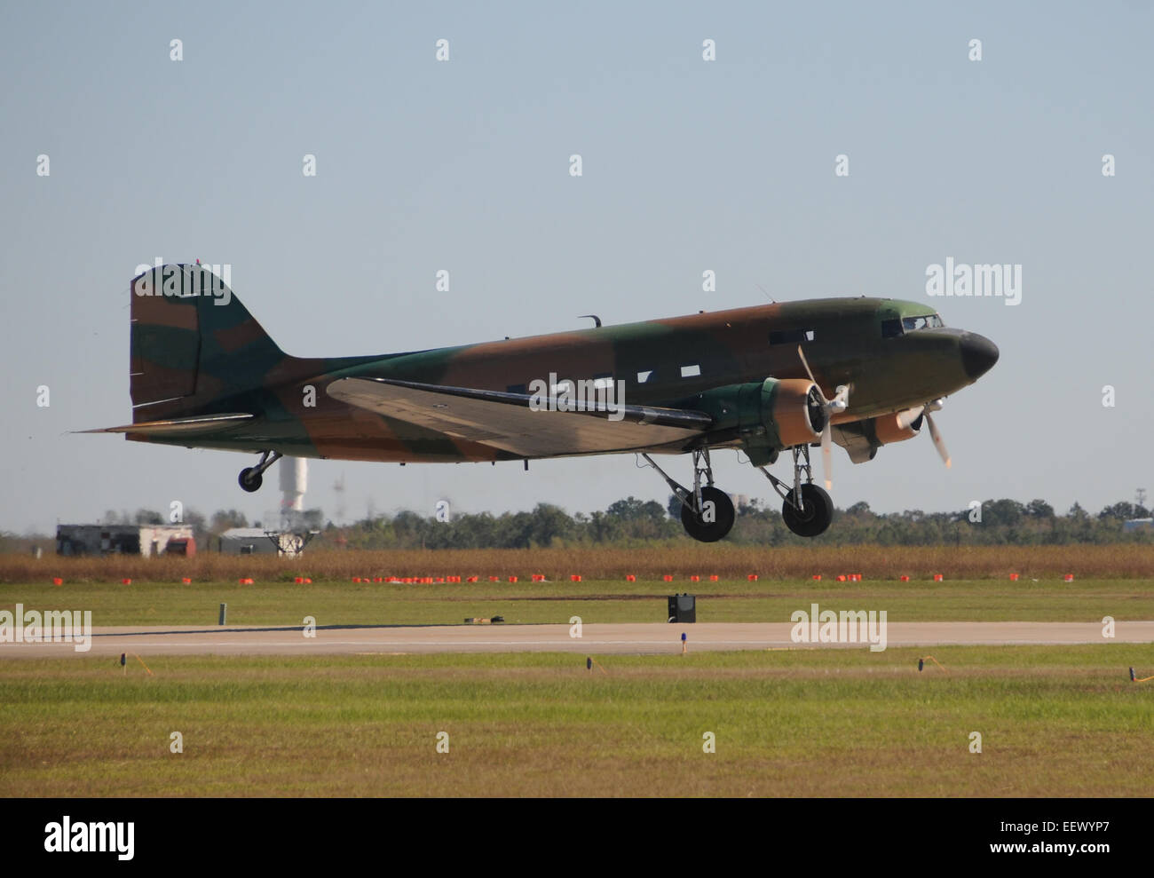 Old propeller airplane taking off from an airfield DC-3 - Stock Image
