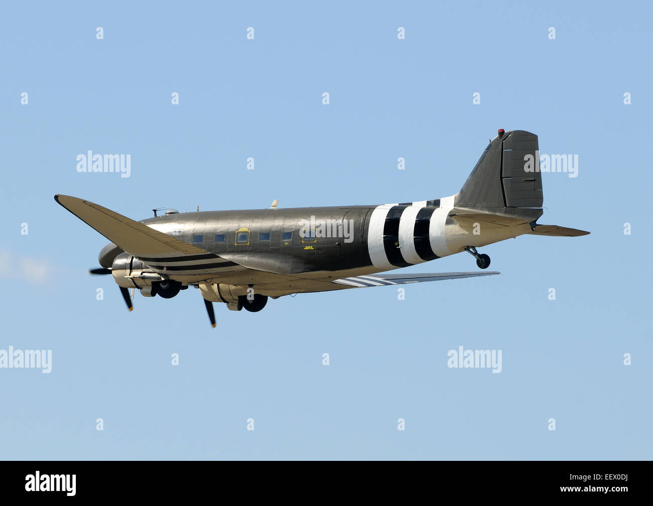 Retro propeller airplane in leveled flight DC-3 - Stock Image