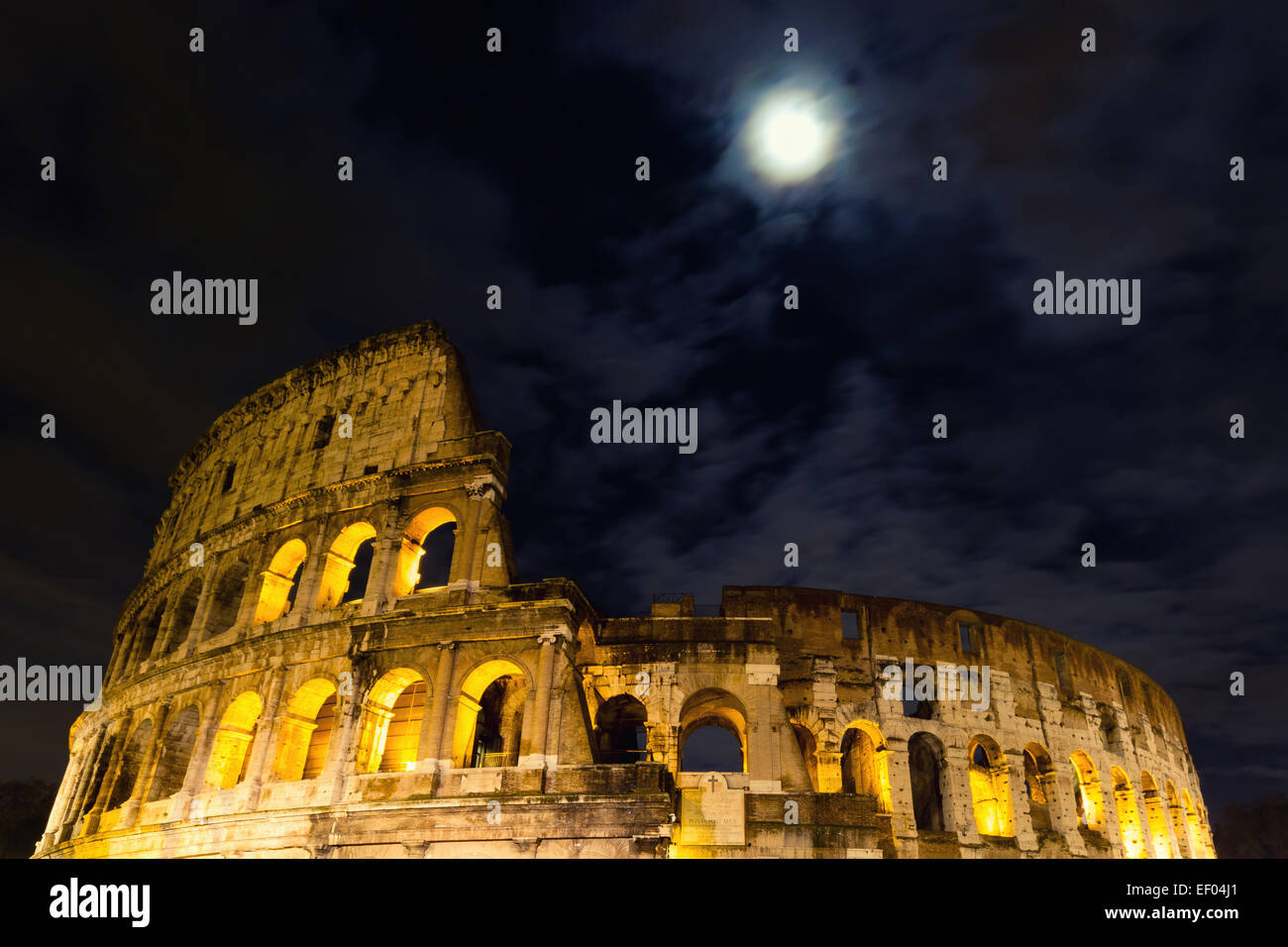 The Coliseum under the full moon, Rome, Italy - Stock Image
