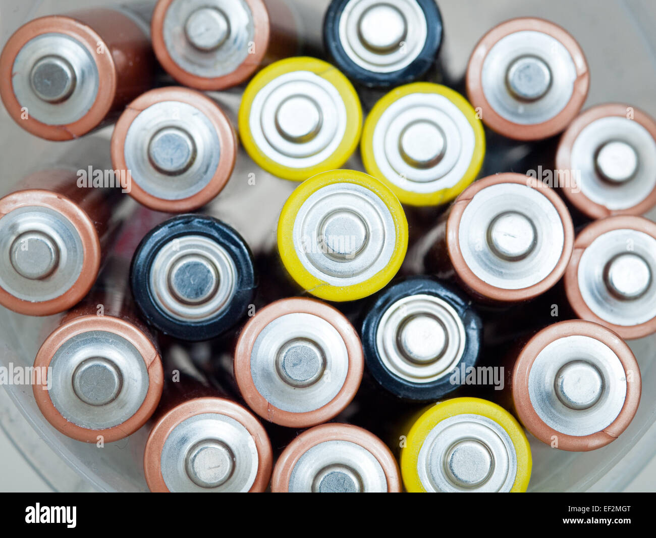 A close-up of used AA (double A) batteries for recycling. - Stock Image