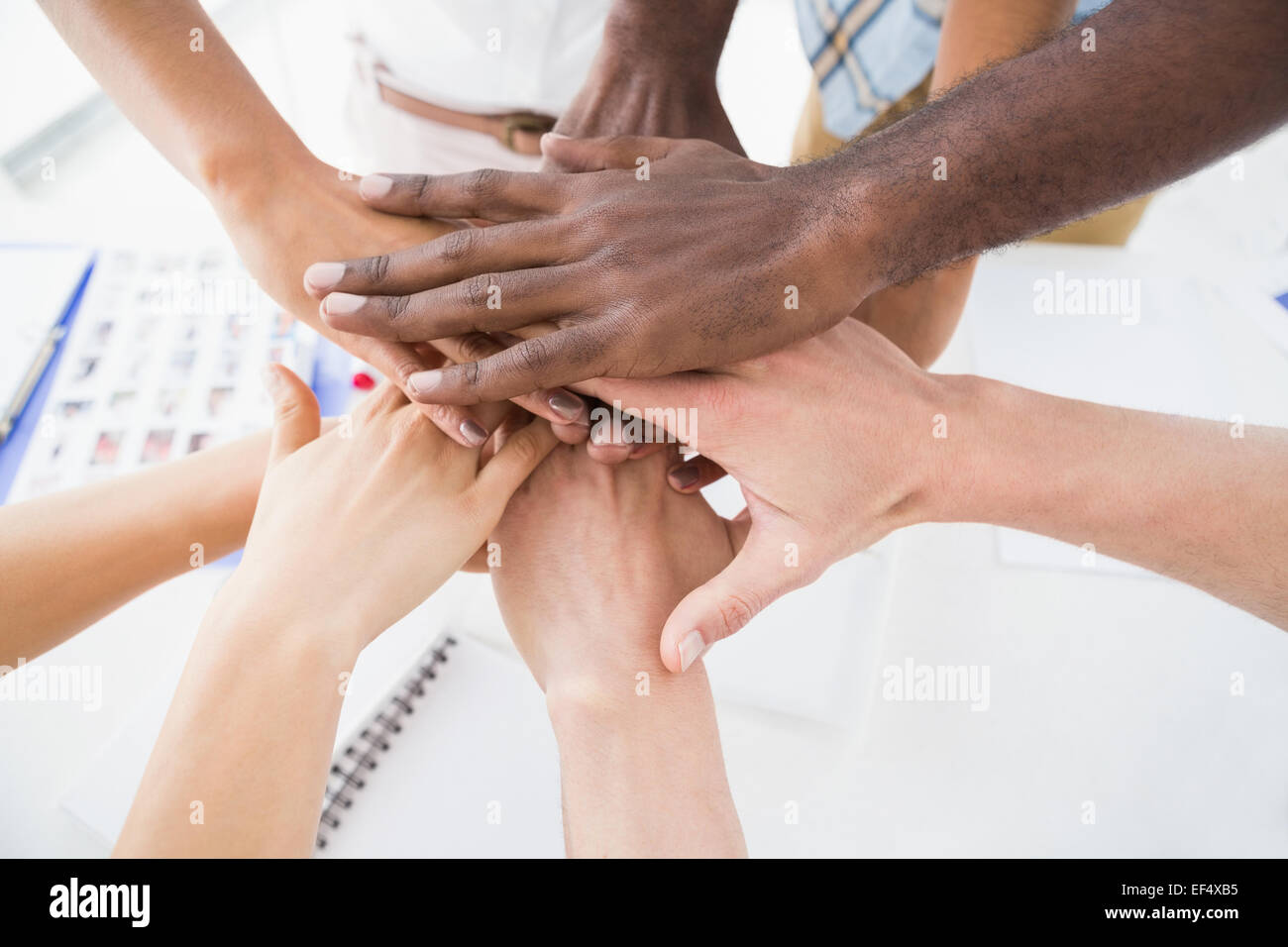 Business people joining hands in a circle - Stock Image