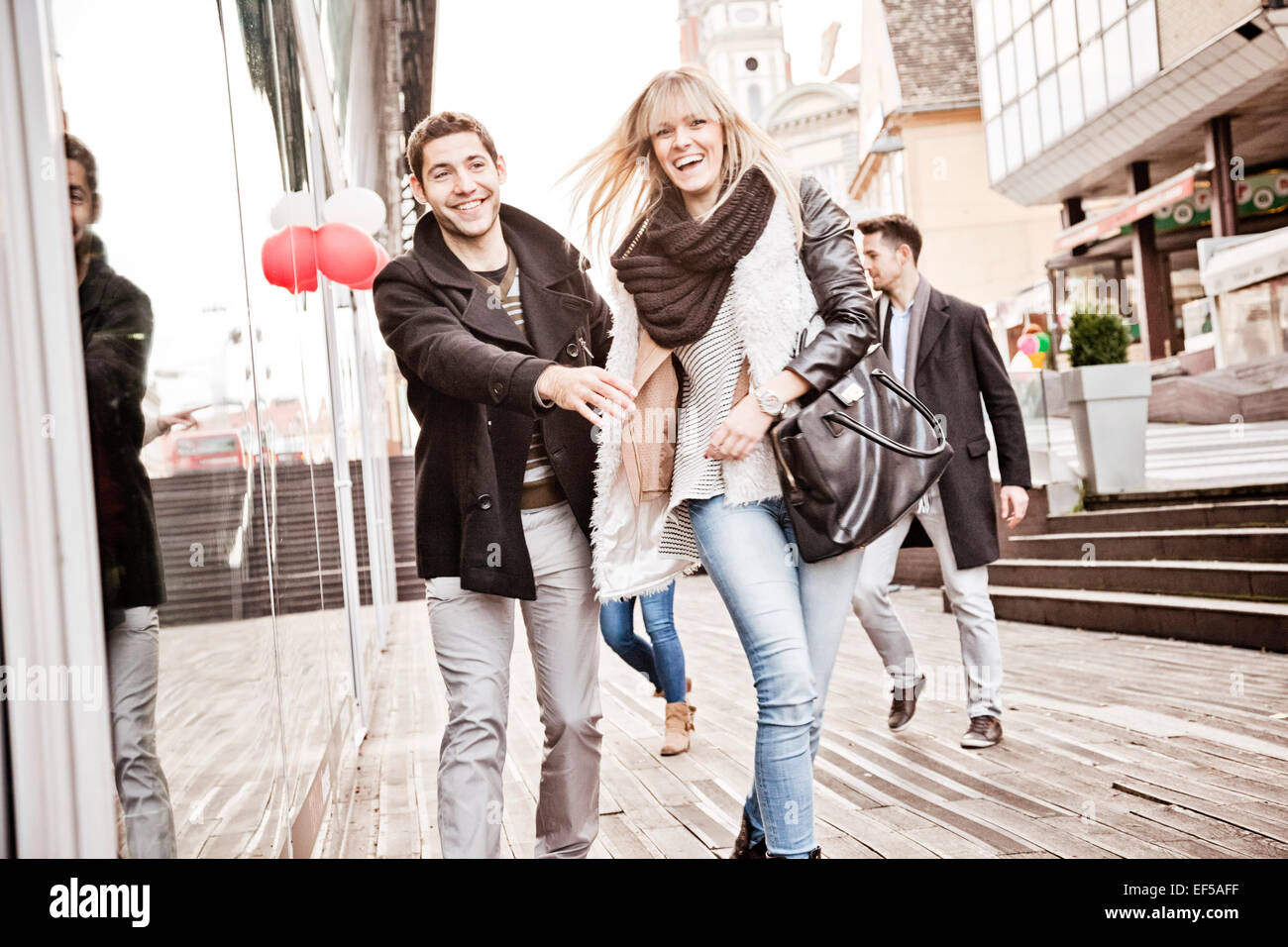 Group of friends having fun on shopping spree - Stock Image