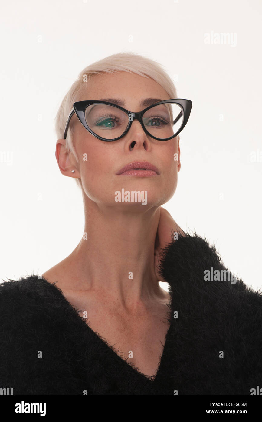 mature woman wearing big framed black glasses with short blonde hair