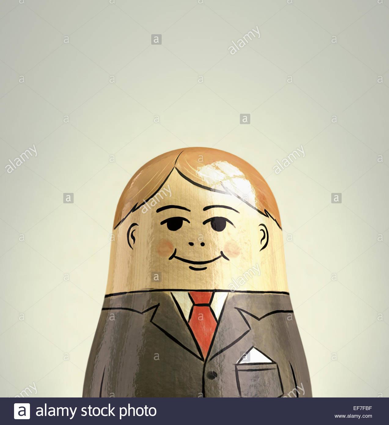 Happy, smiling businessman nesting doll - Stock Image
