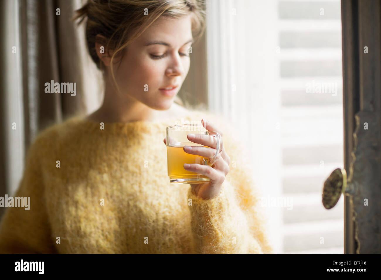 Woman drinking herbal tea - Stock Image