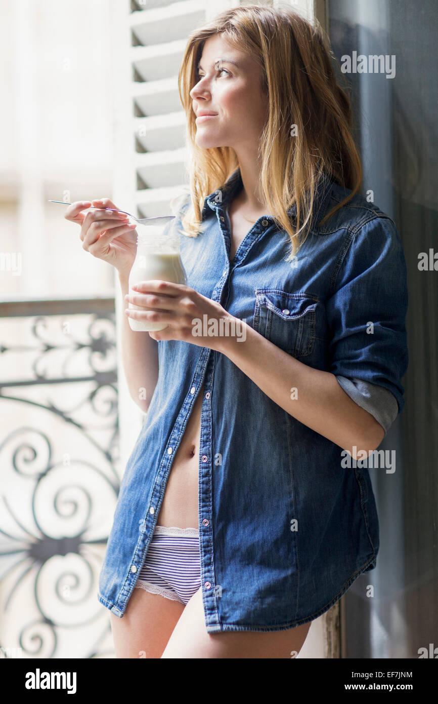 Happy woman drinking milk - Stock Image
