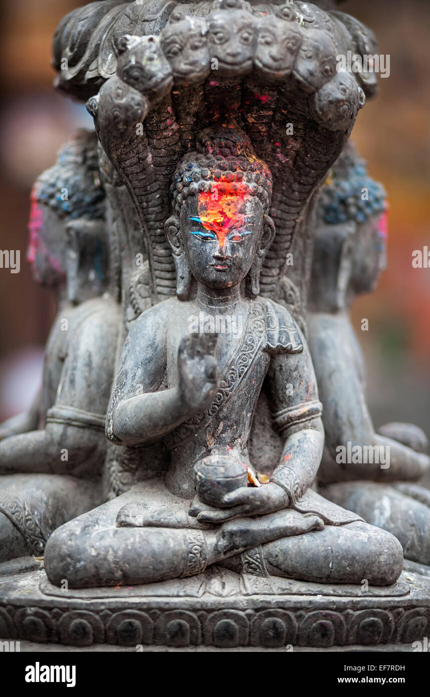 Buddha statue with red color on his forehead in Kathmandu, Nepal - Stock Image