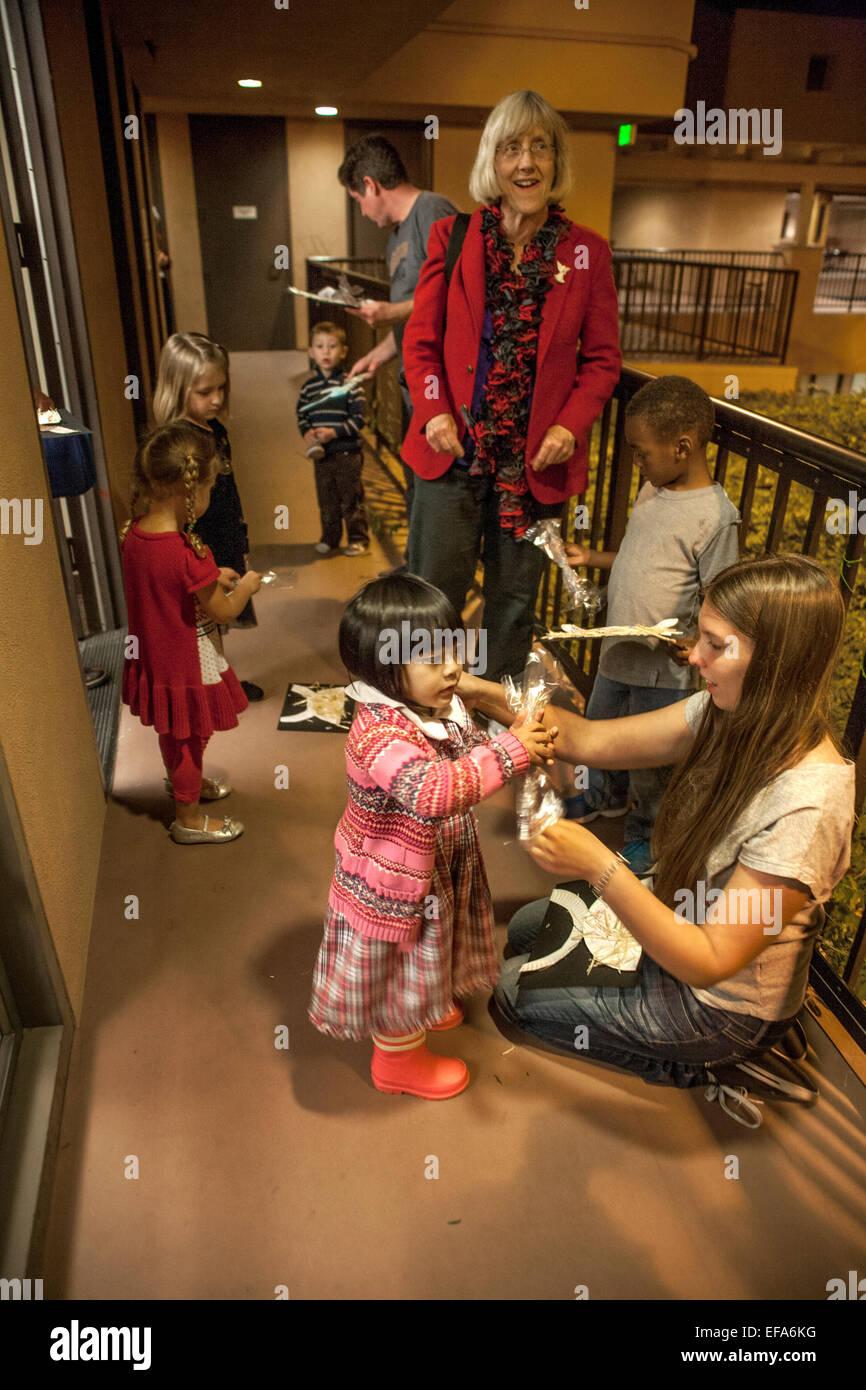 multiethnic children enjoy christmas gifts left by st nicholas at st timothys catholic church laguna niguel ca note adult volunteers