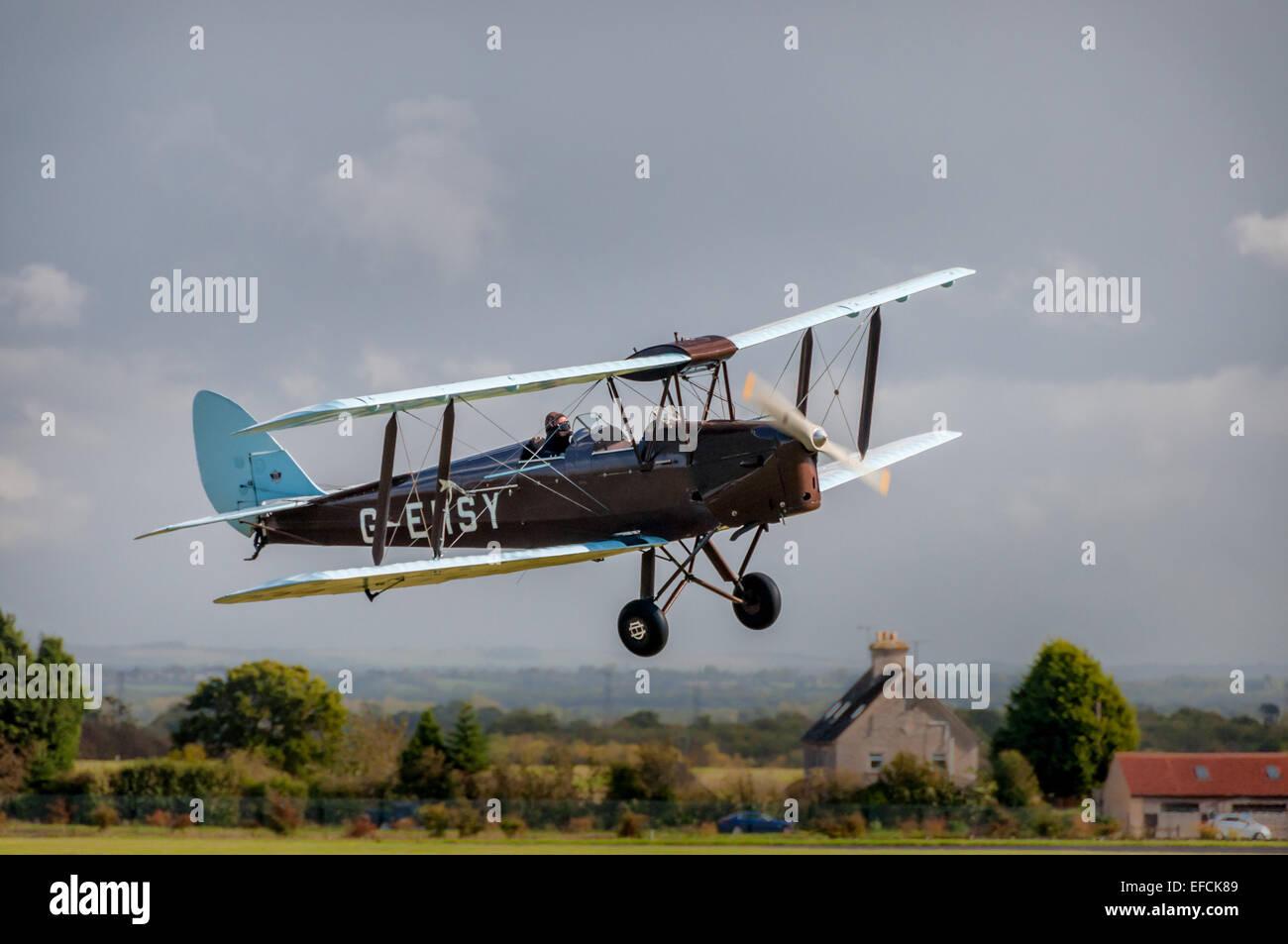 De Havilland Tiger Moth, 1930s biplane at Kemble Airshow - Stock Image