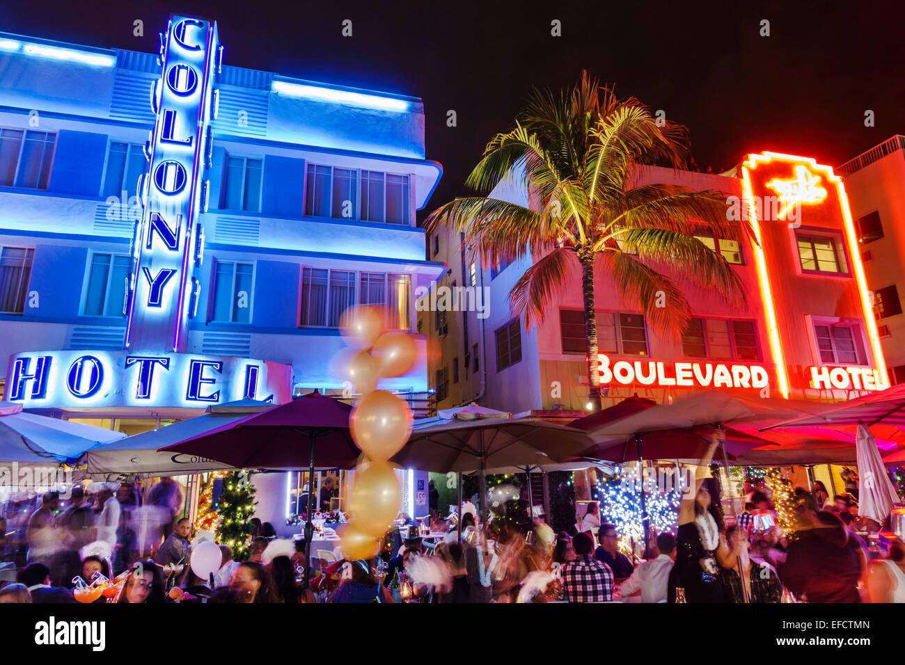 Miami Beach Florida Art Deco District Ocean Drive New Years Eve Night Nightlife Restaurant Alfresco Dining Tables Colony Hotel Boulevard Neon Sign