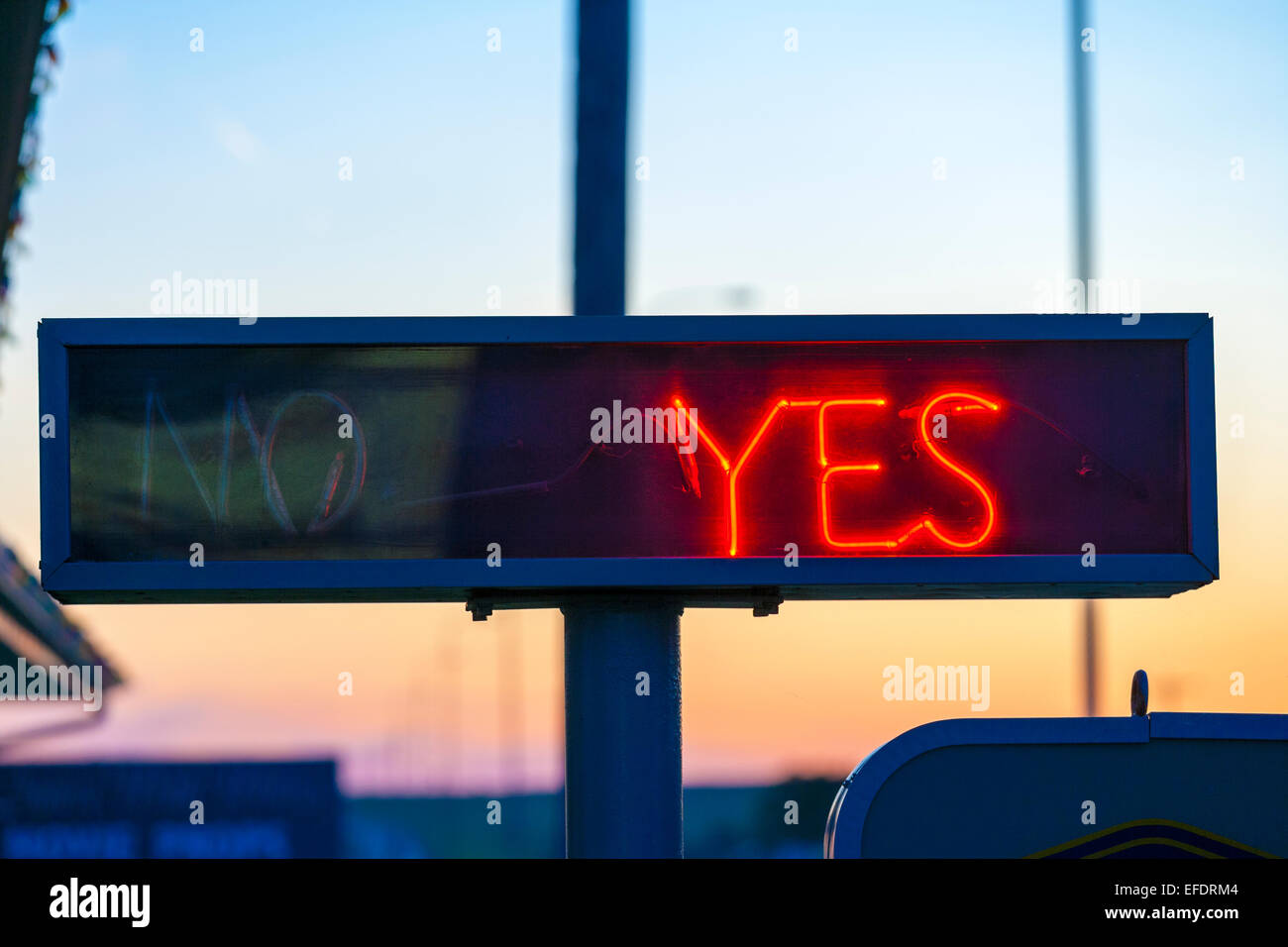Neon sign Yes or No Vacancy at a US motel with Yes light switched on. Stock Photo