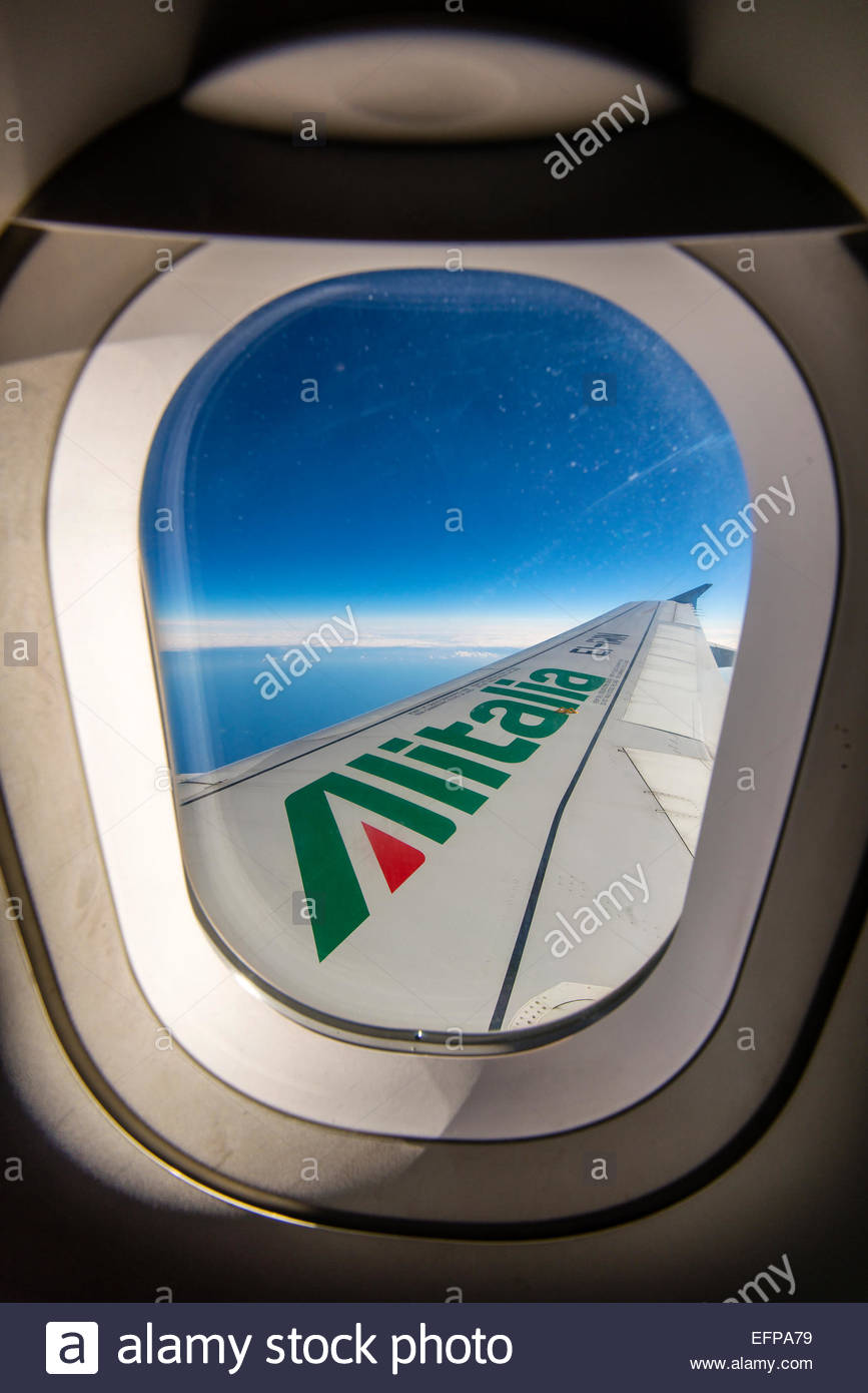 In flight view over the wing of an Alitalia Airbus A319 - Stock Image