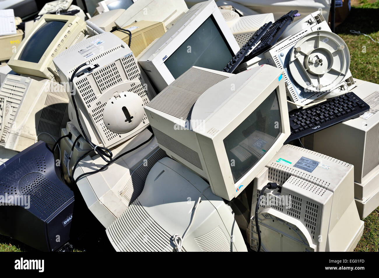 pile-of-old-computer-monitors-and-keyboa