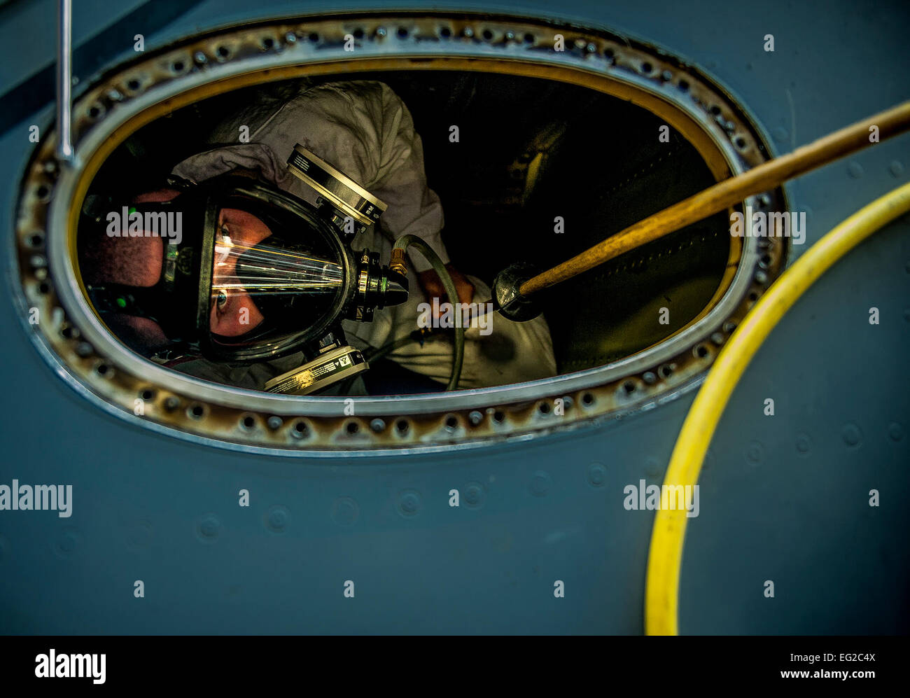 Airman 1st Class Nicholas McKinney looks up from the inside of a C-17 Globemaster III fuel tank during a routine - Stock Image