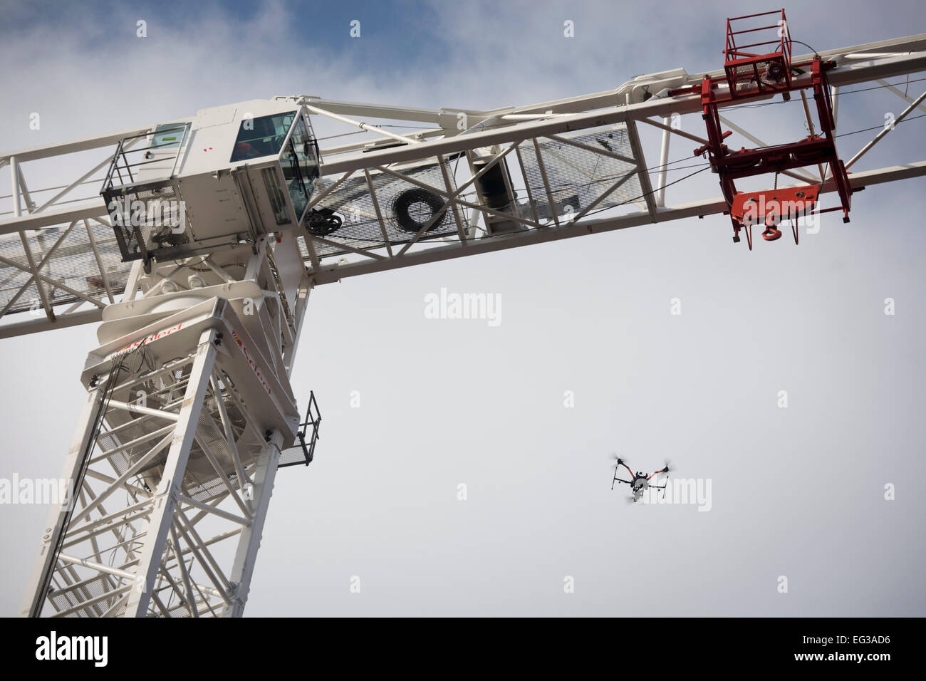 workmen-high-on-the-jib-of-a-crane-that-