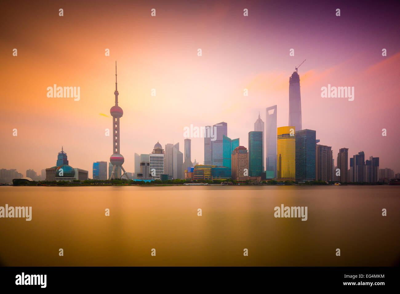 Shanghai, China cityscape viewed across the Huangpu River at dawn. - Stock Image